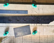 CNC'd fretboard with moon inlays and alien heads